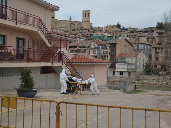 Medical workers evacuating a coronavirus patient from a nursing home in Valderrobres, Spain, this month. Nearly 50 of the 60 residents at the home tested positive for the pathogen.