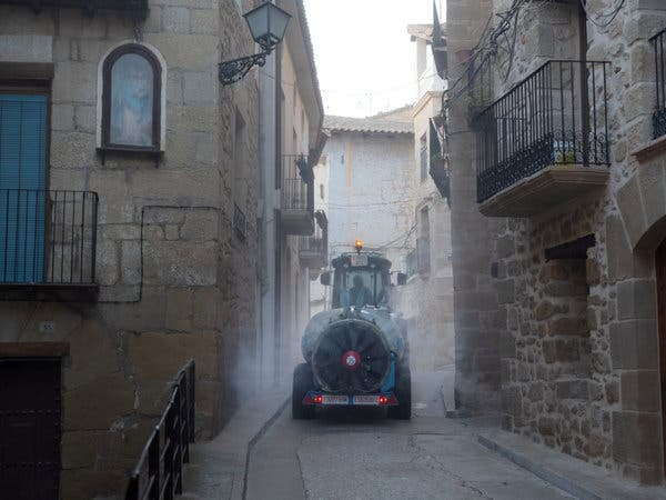 Miguel Angel Caldu, a farmer, disinfected the narrow streets of Valderrobres this month with a spreader normally used to fertilize his vines and fields of almond trees.