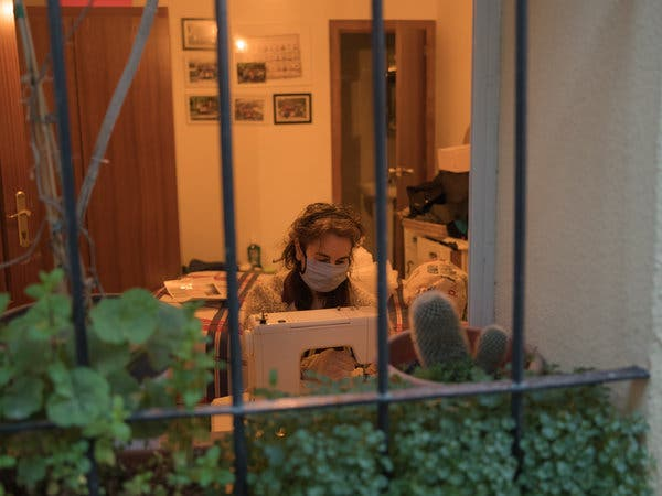 Sara Lombarte sewing masks at her home in Peñarroya de Tastavins.